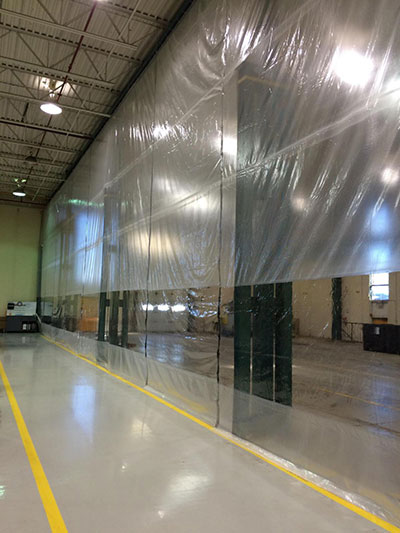 Industrial room divider - vinyl curtain wall