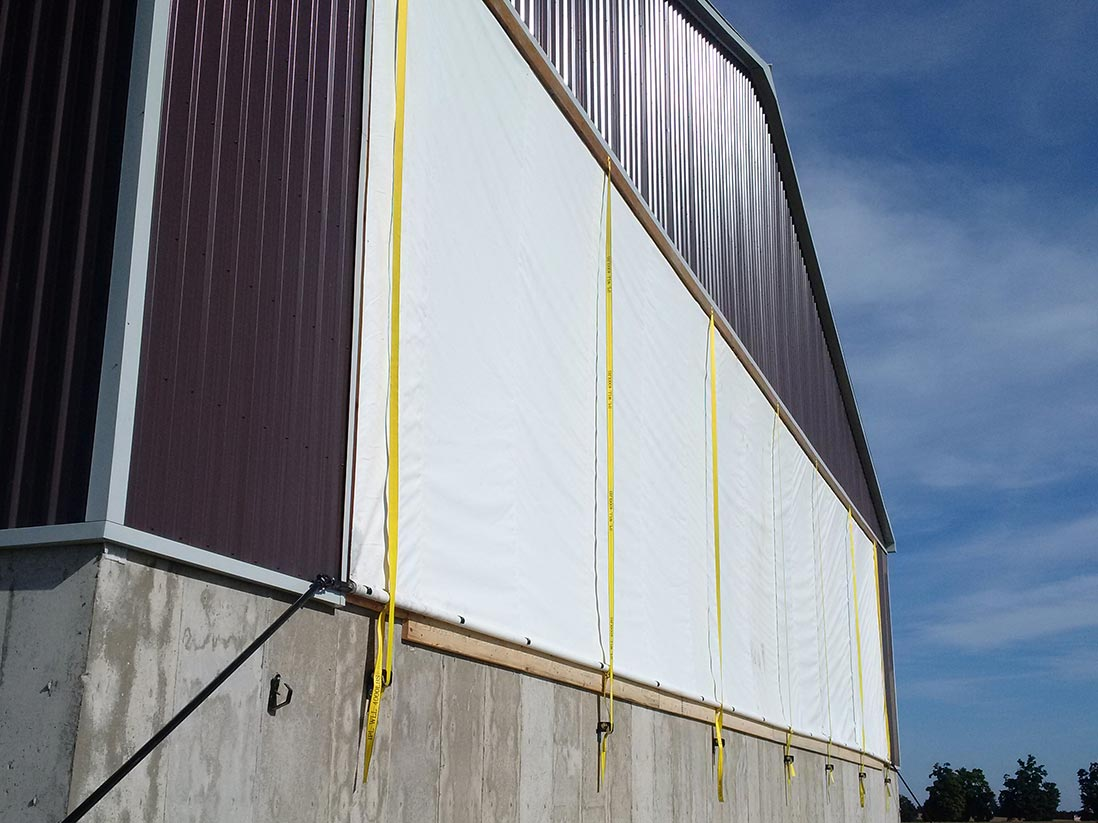 Custom roll up tarp door