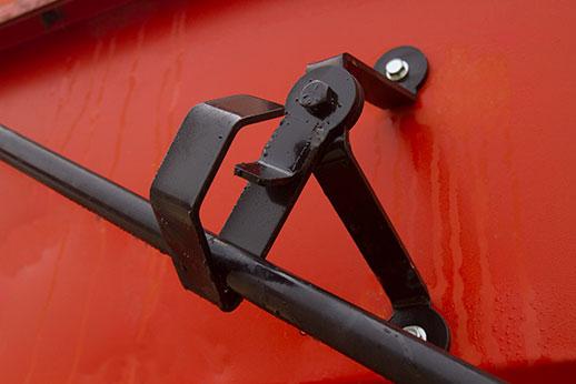 Roll tarp system crank handle cradle
