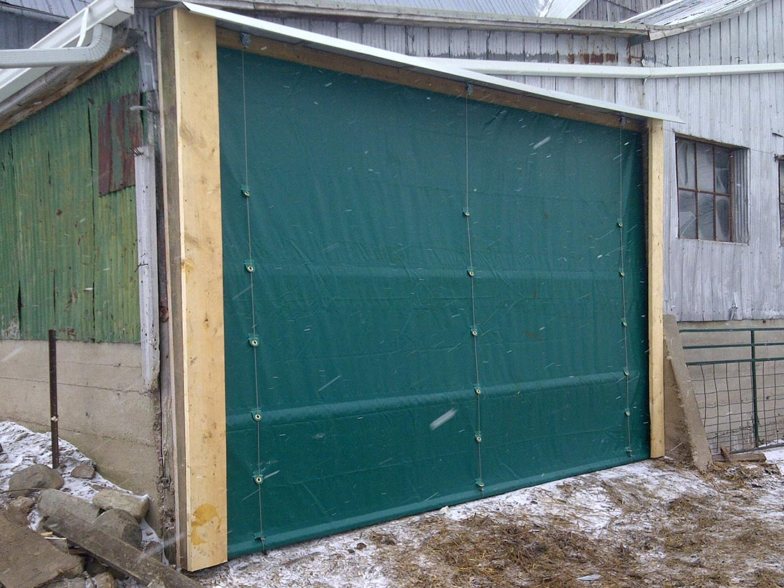 Available with a hand winch or drum drive and up-down switch this door system can be installed up to any length with wind pipe supports. system. & Tarp and vinyl doors room iders and curtains - Martarp Custom ...